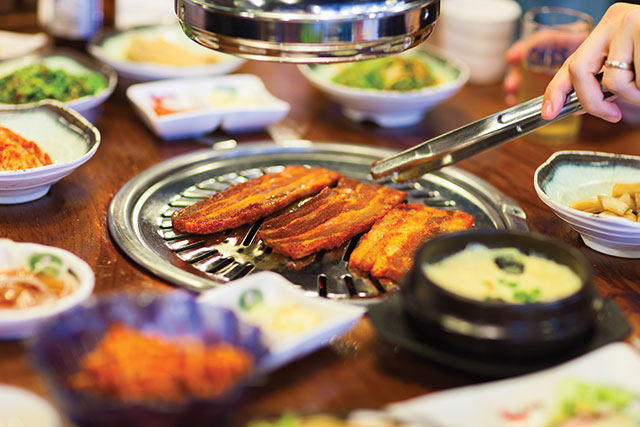 Korean BBQ setting with side dishes