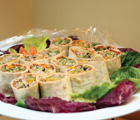 Vegetarian ideas of tortilla rolls and 'satay'